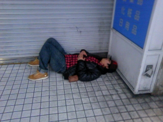 Passed out in front of the closed shop